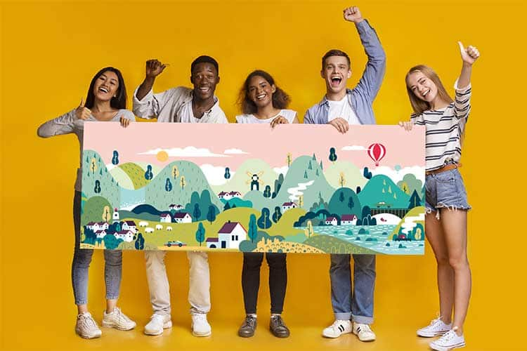 Friends holding a panoramic poster